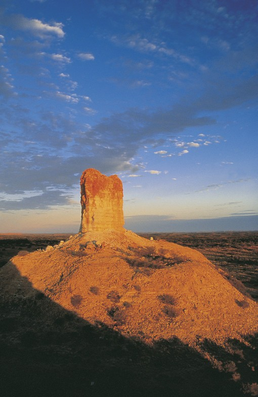 The 50m high sandstone pillar is the main feature of the Chambers Pillar Historical Reserve.